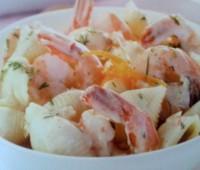 Conchas con gambas en salsa de naranja